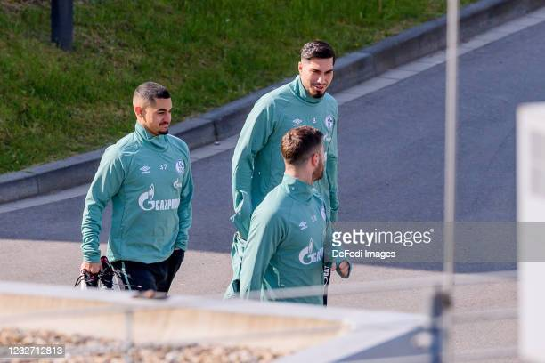 Levent Mercan of FC Schalke 04 and Suat Serdar of FC Schalke 04 look on during the FC Schalke 04 Training Session on May 03, 2021 in Gelsenkirchen,...