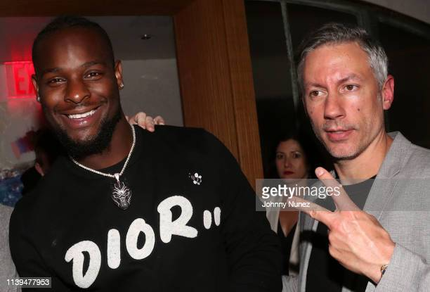 Le'Veon Bell and Barry Mullineaux attend the NFL Draft viewing party hosted By Wale, Le'Veon Bell and Derrick Jones at Pomona on April 25, 2019 in...