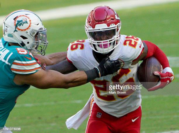 Le'Veon Bell of the Kansas City Chiefs carries the ball against Kamu Grugier-Hill of the Miami Dolphins during the first half of the game at Hard...