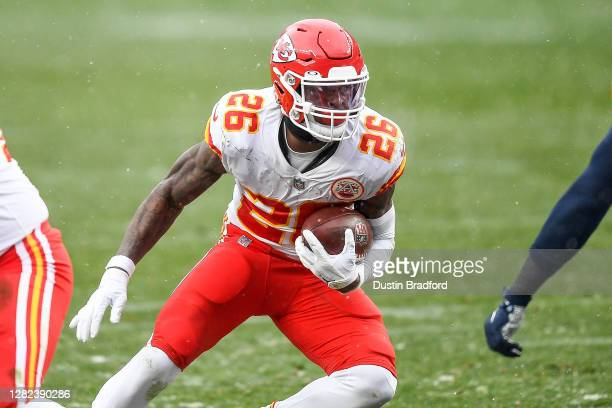 Le'Veon Bell of the Kansas City Chiefs carries the ball against the Denver Broncos at Empower Field at Mile High on October 25, 2020 in Denver,...