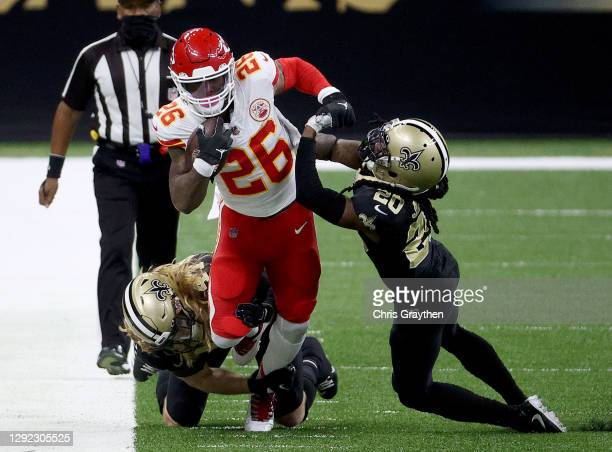 Le'Veon Bell of the Kansas City Chiefs is pushed out of bounds by Janoris Jenkins of the New Orleans Saints during the first quarter in the game at...