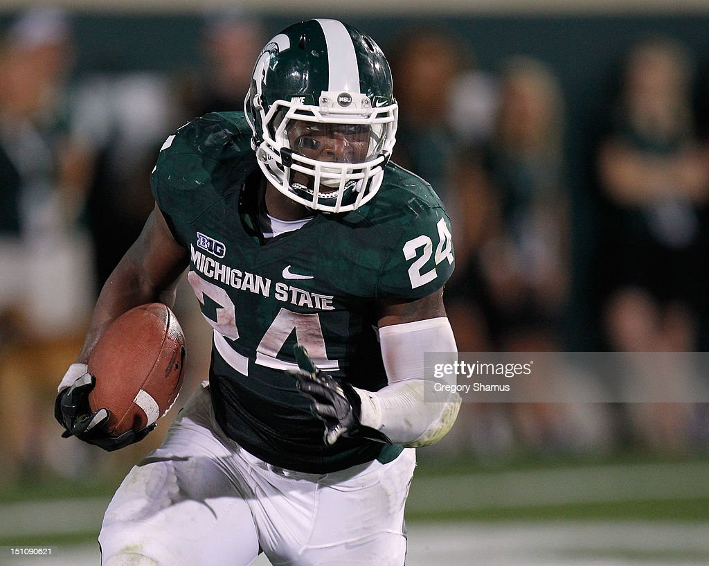 Le'Veon Bell #24 of the Michigan State Spartans looks for running room during a third quarter run while playing the Boise State Broncos at Spartan Stadium on August, 2010 in East Lansing, Michigan.