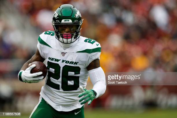 Le'Veon Bell of the New York Jets carries the ball against the Washington Redskins during the first half at FedExField on November 17, 2019 in...