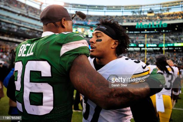 Le'Veon Bell of the New York Jets greets Jordan Dangerfield of the Pittsburgh Steelers after the game at MetLife Stadium on December 22, 2019 in East...
