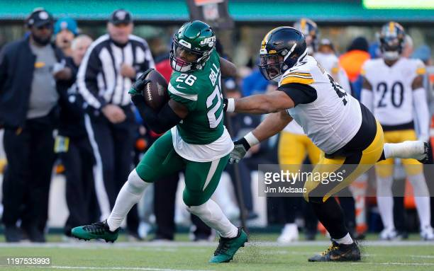 Le'Veon Bell of the New York Jets in against Cameron Heyward of the Pittsburgh Steelers at MetLife Stadium on December 22, 2019 in East Rutherford,...