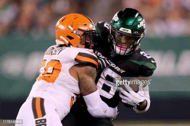 Le'Veon Bell of the New York Jets is tackled by Christian Kirksey of the Cleveland Browns at MetLife Stadium on September 16 2019 in East Rutherford...