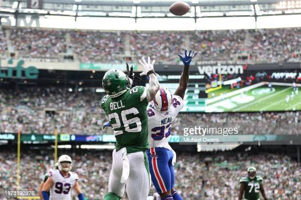 Le'Veon Bell of the New York Jets makes a catch over Siran Neal of the Buffalo Bills for a two point conversion during the third quarter at MetLife...
