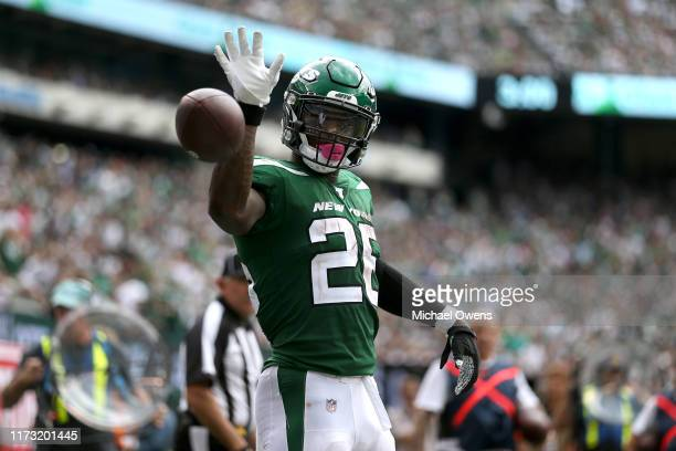 Le'Veon Bell of the New York Jets signals for a first down against the Buffalo Bills during the at MetLife Stadium on September 08, 2019 in East...