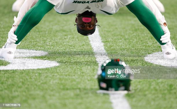 Le'Veon Bell of the New York Jets stretches during warmups prior to facing the Atlanta Falcons in the preseason game at Mercedes-Benz Stadium on...