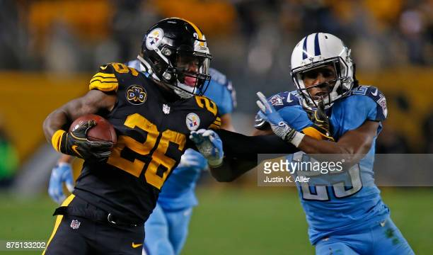 Le'Veon Bell of the Pittsburgh Steelers carries the ball as he stiff arms Adoree' Jackson of the Tennessee Titans in the second half during the game...