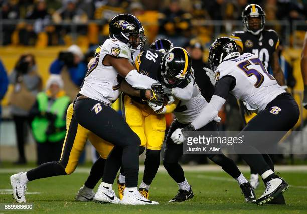 Le'Veon Bell of the Pittsburgh Steelers is gang tackled by the Baltimore Ravens in the second half during the game at Heinz Field on December 10 2017...
