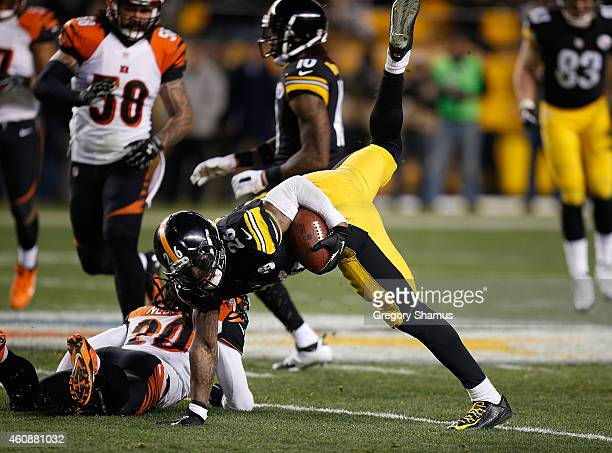 Le'Veon Bell of the Pittsburgh Steelers is injured after being hit by Reggie Nelson of the Cincinnati Bengals during the third quarter at Heinz Field...