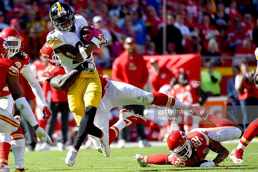 Le'Veon Bell #26 of the Pittsburgh Steelers is tackled by Allen Bailey #97 of the Kansas City Chiefs at Arrowhead Stadium during the fourth quarter of the game on October 25, 2015 in Kansas City, Missouri.