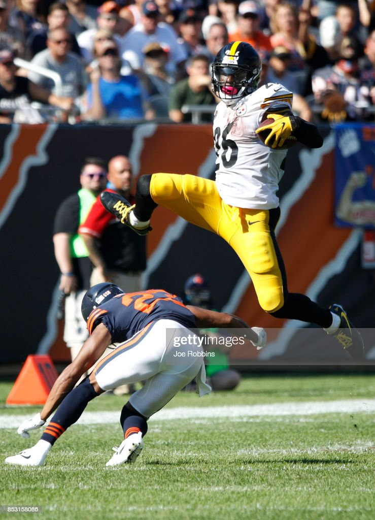 Le'Veon Bell #26 of the Pittsburgh Steelers jumps over Kyle Fuller #23 of the Chicago Bears in the fourth quarter at Soldier Field on September 24, 2017 in Chicago, Illinois.