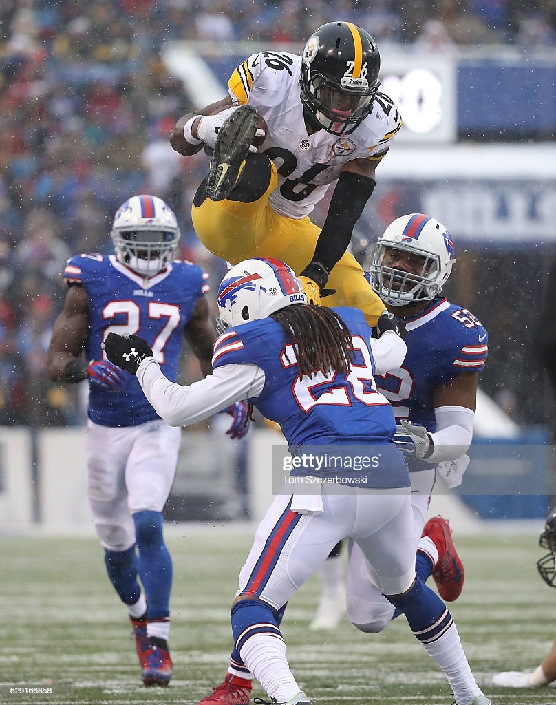 Le'Veon Bell #26 of the Pittsburgh Steelers jumps over Ronald Darby #28 of the Buffalo Bills during the second half at New Era Field on December 11, 2016 in Orchard Park, New York.
