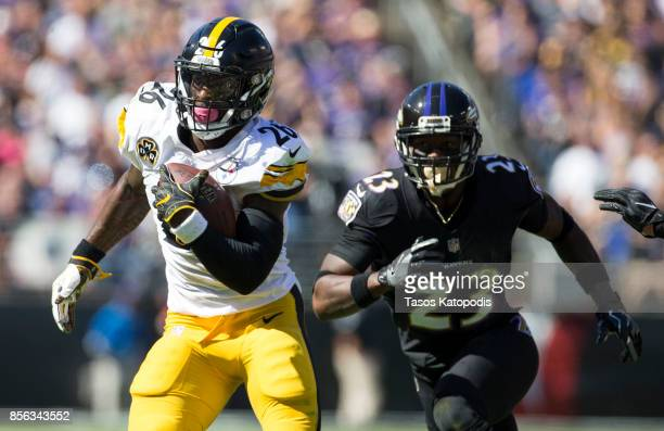 Le'Veon Bell of the Pittsburgh Steelers runs past Tony Jefferson of the Baltimore Ravens the first quarter at MT Bank Stadium on October 1 2017 in...