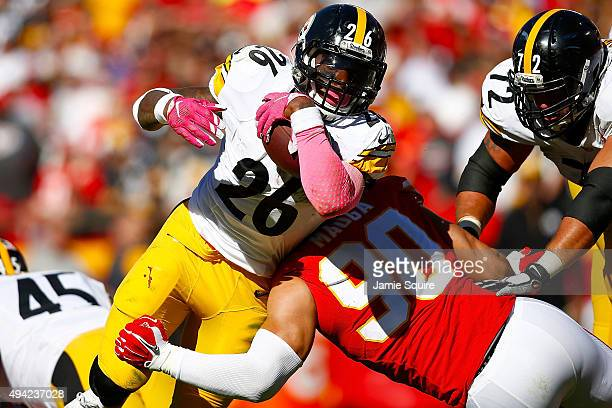 Le'Veon Bell of the Pittsburgh Steelers runs through the tackle attempt Josh Mauga of the Kansas City Chiefs at Arrowhead Stadium during the fourth...