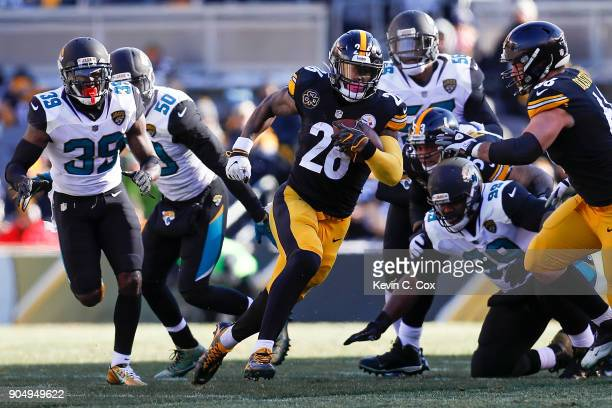 Le'Veon Bell of the Pittsburgh Steelers runs with the ball against the Jacksonville Jaguars during the first half of the AFC Divisional Playoff game...