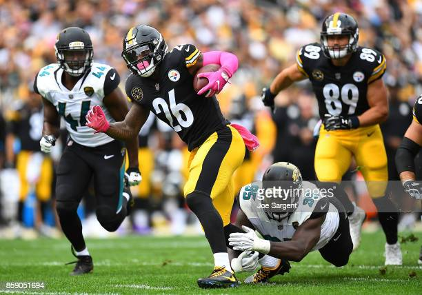 Le'Veon Bell of the Pittsburgh Steelers rushes against the Jacksonville Jaguars in the first quarter during the game at Heinz Field on October 8 2017...