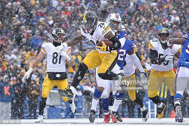 Le'Veon Bell of the Pittsburgh Steelers scores a touchdown against the Buffalo Bills during the first half at New Era Field on December 11 2016 in...