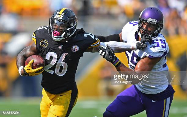 Le'Veon Bell of the Pittsburgh Steelers stiff arms Anthony Barr of the Minnesota Vikings as he carries in the ball in the second half during the game...
