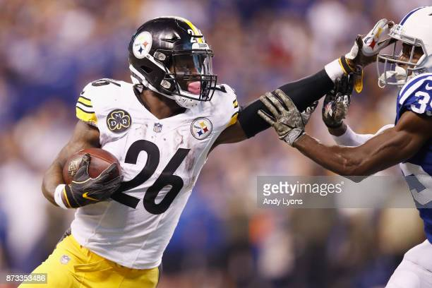 Le'Veon Bell of the Pittsburgh Steelers stiff arms Pierre Desir of the Indianapolis Colts during the second half at Lucas Oil Stadium on November 12...