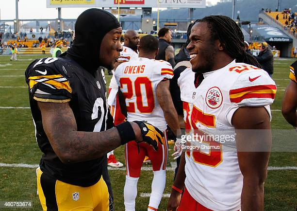 Le'Veon Bell of the Pittsburgh Steelers talks with Jamaal Charles of the Kansas City Chiefs after Pittsburgh's 2012 win at Heinz Field on December 21...