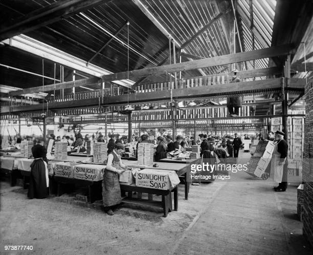 Lever Brothers Sunlight Soap Works, Port Sunlight, Wirral, Merseyside, 1897. Interior view showing workers packing soap boxes. Artist Henry Bedford...