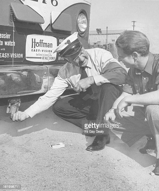 SEP 25 1953 SEP 27 1953 Leverett shows Clancy the detonator used in braking test The detonator fires a 22 cartridge which blasts a charge of chalk on...