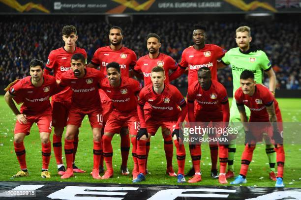 Leverkusen players pose for a photograph prior to the UEFA Europa League round of 16 first leg football match between Rangers FC and Bayer 04...