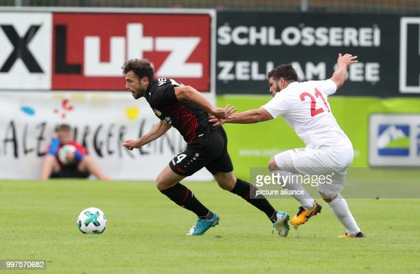 Leverkusen's Admir Mehmedi and Antalya's Mostapha El Kabir vie for the ball in the soccer friendly between Bayer Leverkusen and Antalyaspor in Zell...