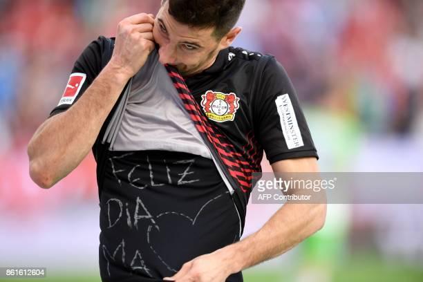 Leverkusen's Argentinian striker Lucas Alario celebrates after scoring the 21 during the German first division Bundesliga football match Bayer...