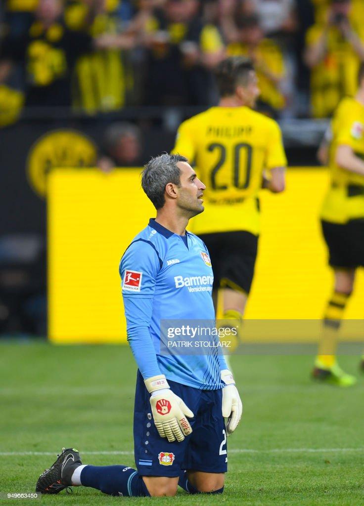 Leverkusen's Austrian goalkeeper Ramazan Oezcan reacts during the German first division Bundesliga football match Borussia Dortmund vs Bayer Leverkusen, in Dortmund, western Germany, on April 21, 2018. (Photo by Patrik STOLLARZ / AFP)