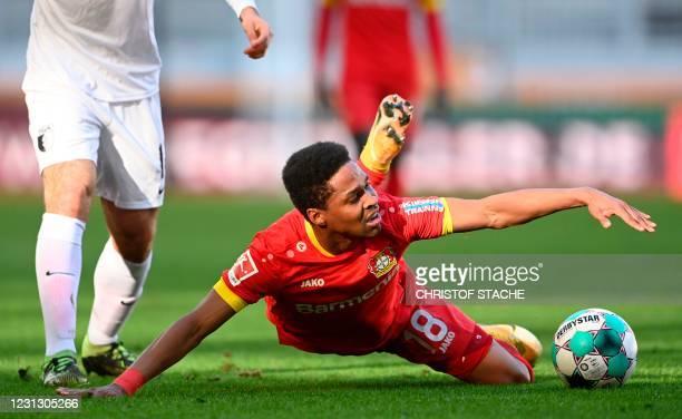 Leverkusen's Brazilian defender Wendell falls on the pitch during the German first division Bundesliga football match FC Augsburg vs Bayer Leverkusen...