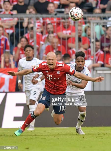 Leverkusen's Brazilian defender Wendell fouls Bayern Munich's Dutch midfielder Arjen Robben during the German First division Bundesliga football...
