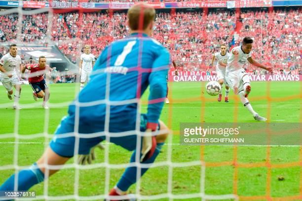 Leverkusen's Brazilian defender Wendell shoots a penalty kick before scoring during the German First division Bundesliga football match between FC...