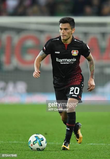 Leverkusen's Chilean midfielder Charles Aranguiz plays the ball during the German first division Bundesliga football match FC Augsburg vs Bayer...