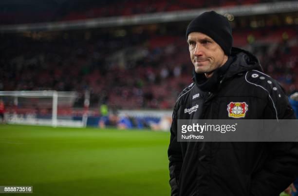 Leverkusens coach Heiko Herrlich watches his team warming up during the Bundesliga match between VfB Stuttgart and Bayer 04 Leverkusen at...
