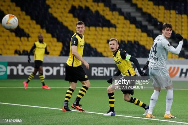 Leverkusen's Czech forward Patrik Schick scores a goal during the UEFA Europa League round of 32 first leg football match between BSC Young Boys and...