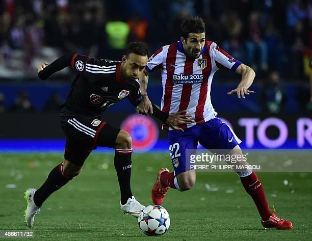 Leverkusen's forward Karim Bellarabi vies with Atletico Madrid's midfielder Cani during the UEFA Champions League football match Club Atletico de...