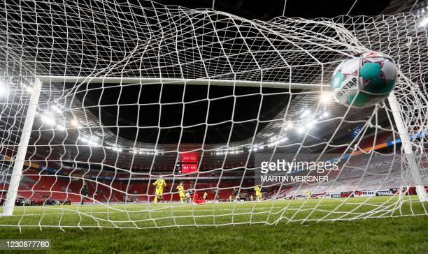 Leverkusen's French forward Moussa Diaby scores the opening goal during the German first division Bundesliga football match Bayer 04 Leverkusen v BVB...