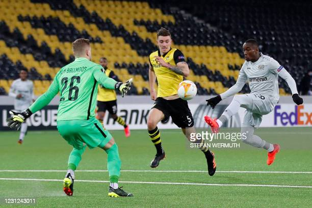 Leverkusen's French forward Moussa Diaby shoots to score during the UEFA Europa League round of 32 first leg football match between BSC Young Boys...