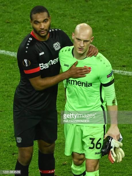 Leverkusen's German defender Jonathan Tah and Leverkusen's German goalkeeper Niklas Lomb react after the UEFA Europa League last-32, 2nd-leg football...