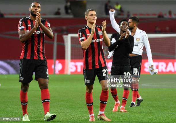 Leverkusen's German defender Jonathan Tah, Leverkusen's German forward Florian Wirtz, Leverkusen's Dutch defender Jeremie Frimpong and Leverkusen's...