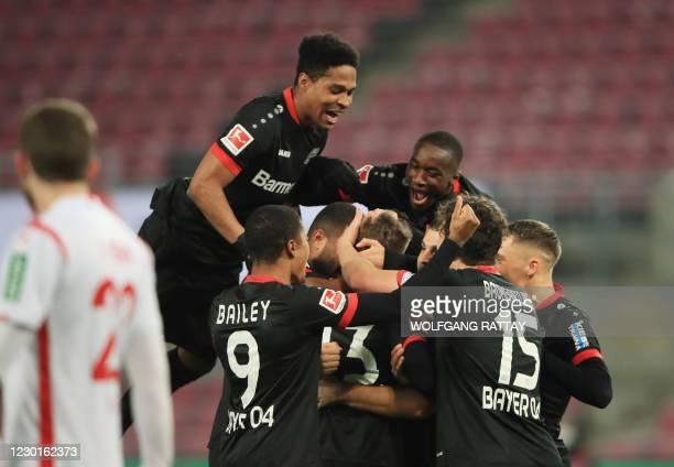 Leverkusen's German defender Mitchell Weiser celebrates scoring the first goal with teammates during the German first division Bundesliga football...