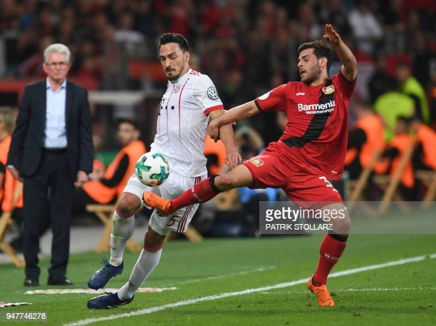 Leverkusen's German forward Kevin Volland and Bayern Munich's German defender Mats Hummels vie for the ball during the German football Cup DFB Pokal...