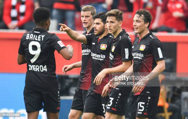Leverkusen's German forward Kevin Volland and his teammates celebrates scoring during the German first division Bundesliga football match Bayer 04...