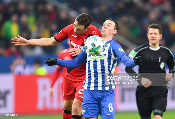 Leverkusen's German midfielder Dominik Kohr and Berlin's Czech midfielder Vladimir Darida vie for the ball during the German first division...