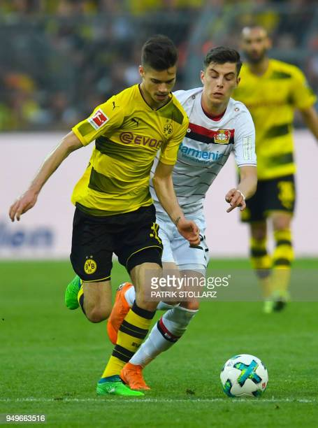 Leverkusen's German midfielder Dominik Kohr and Dortmund's German midfielder Julian Weigl vie for the ball during the German first division...
