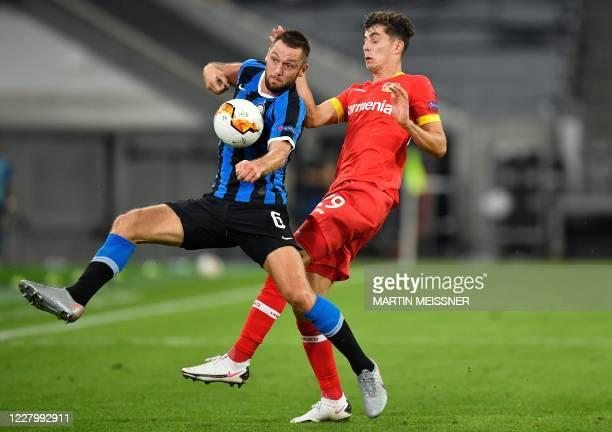 Leverkusen's German midfielder Kai Havertz and Inter Milan's Dutch defender Stefan de Vrij vie for the ball during the UEFA Europa League...